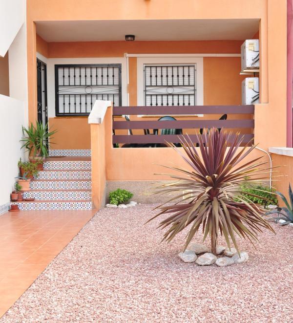 Front garden with veranda - Lovely ground floor, 2 bedroom apartment - Punta Prima - rentals