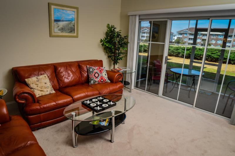 Living room with patio access - Great 2BR condo @ Edgewater 612 in Barefoot Resort - North Myrtle Beach - rentals