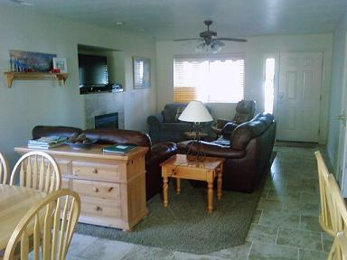 Open living room and dining room with patio access. Go right out the back door and go right to the pools and playground! Great for the kids! - # 904 Las Palmas - Saint George - rentals