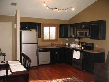 Open living room and dining area with vaulted ceilings. It is fully stocked with all cooking utensils and - # E9 The Sports Village - Saint George - rentals