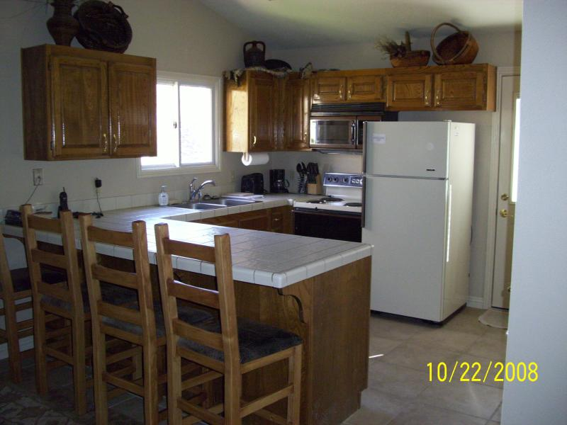 Great kitchen area with all utensils and cooking wear needed to make those