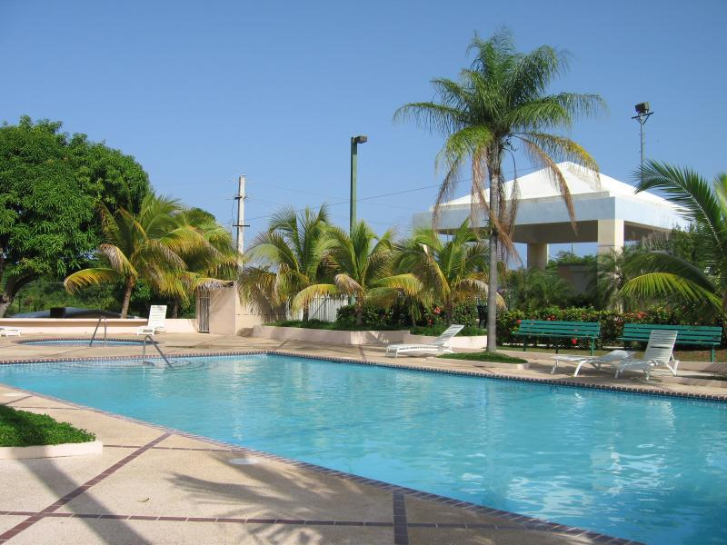 View of pool with gazebo on background - Spacious Condo with Spectacular Ocean Views - sleeps six - Maunabo - rentals