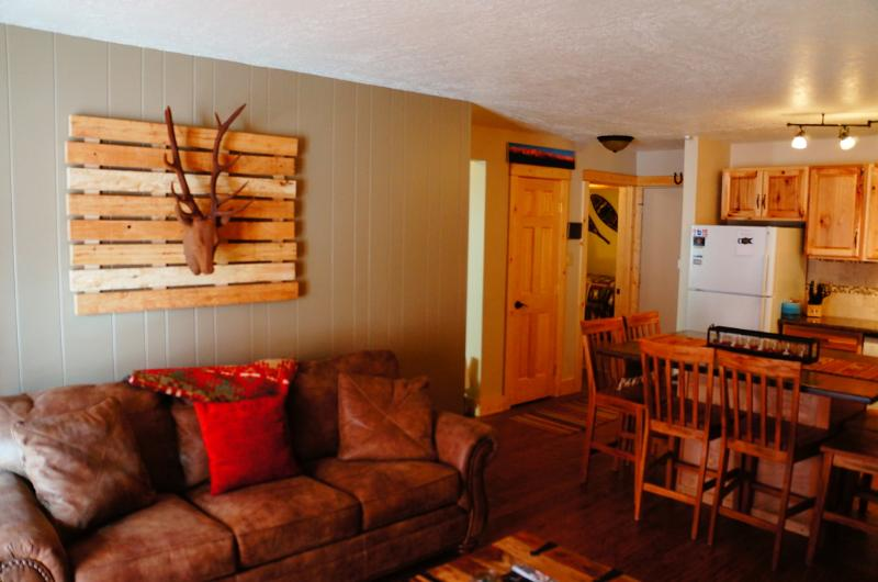 Cozy living room with corner fireplace also includes a queen pullout w/ memory foam mattress - The Antlers Den - Dillon, CO Mountain Condo - Dillon - rentals