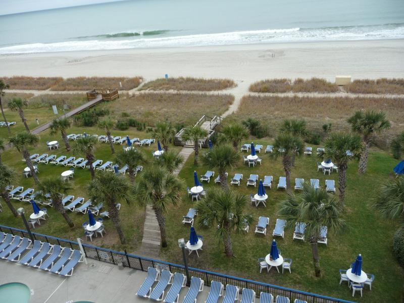 View from the balcony, grassy seating area - Buy 5 nights Get 2 Free!  8/22-8/29$700 - Myrtle Beach - rentals