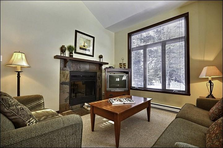 The Welcoming Living Area Offering you a Wood Burning Fireplace - Cozy Wood Burning Fireplace - Community Outdoor Summer Swimming Pool (6017) - Mont Tremblant - rentals