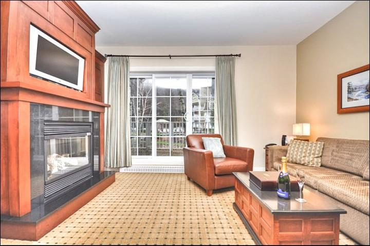 Stylish Living Room Features a Flat Screen HDTV and Gas Fireplace - 25 Minute Walk into Village - Warm Atmosphere and Tasteful Decor (6030) - Mont Tremblant - rentals