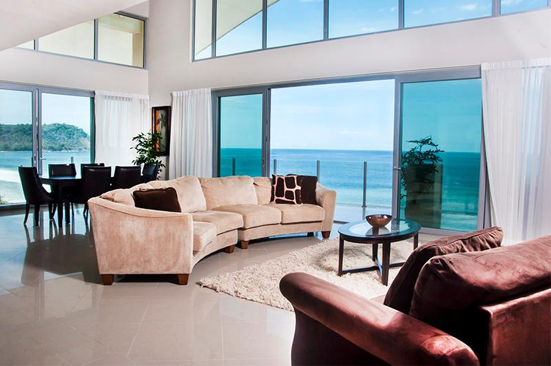 living area with sliding glass doors that open up to a private wrap around balcony - Diamante del Sol 10-2S Penthouse - Jaco - rentals