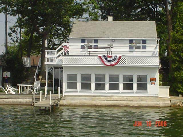 Exterior Lakeview - Upper deck, lower deck and interior sun porch, overlooking Pine Lake - Lake Cottages Don't Get Any Better ~ New Updates! - Plainwell - rentals