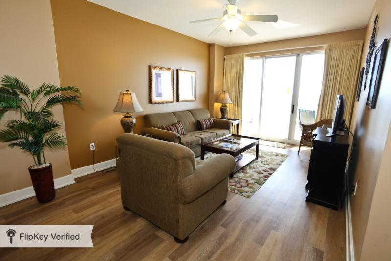 The large living room has plenty of seating, and opens to the balcony overlooking the beautiful Gulf - $300 OFF week of June 6th  only - 3 Bdrm Condo - Panama City Beach - rentals