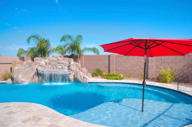 Large outdoor pool with surrounding locking safety gate, grotto, and waterslide! - Wonderful New 5BR Home with Pool,Slide and Grotto! - Gilbert - rentals