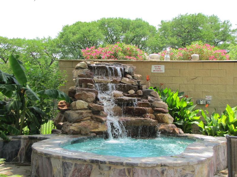 Enjoy one of four hot tubs at Waterwheel Resort Condominiums. - Relaxing New Braunfels Waterfront Condo Waterwheel - New Braunfels - rentals