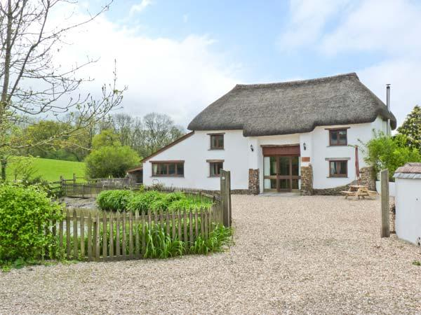 GROVES FISHLEIGH, detached, thatched barn convsersion, woodburner, walking distance from Tarka Trail, near Hatherleigh, Ref 31052 - Image 1 - Hatherleigh - rentals