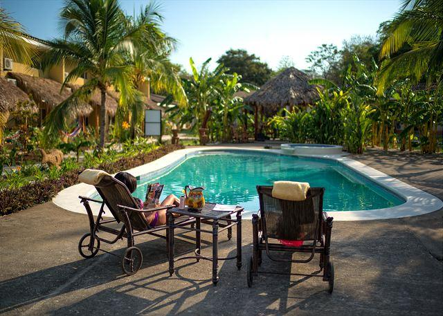 Pool Area - BRAND NEW LUXURY CONDO! 7 MINUTES FROM 7 BEACHES. BEST DEAL IN TOWN! - Playa Grande - rentals