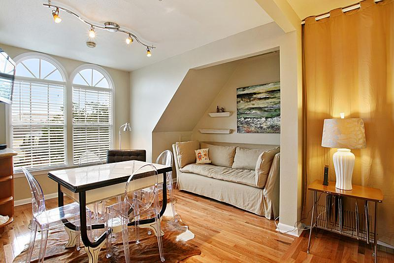 Living room with down sofa and SONY HDTV.  Amazing views showcasing the walkable location. - Garden District Luxury, Steps to St. Charles - New Orleans - rentals