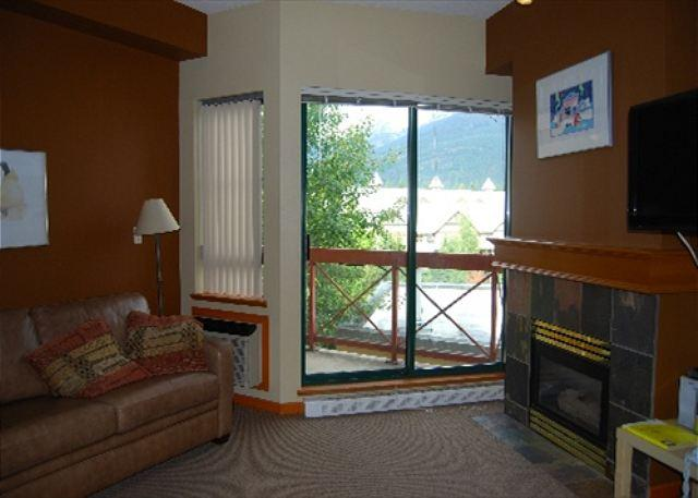 Living room view of balcony - Market Pavilion 314 - central studio apartment with full kitchen & free wifi - Whistler - rentals