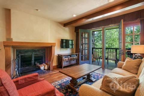 Listen to the flowing creek in this beautiful sunken living room with wood fireplace, flat screen TV and DVD player. - SUMMER SPECIALS~BOOK NOW~ Heart of Beaver Creek~ Outdoor Hot Tub~ Balcony & Views of creek! Beautiful! - Avon - rentals