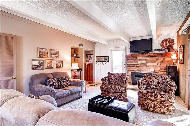 Spacious Living Room with a TV and Fireplace - In the Four Seasons Neighborhood - Updated Throughout (4402) - Breckenridge - rentals