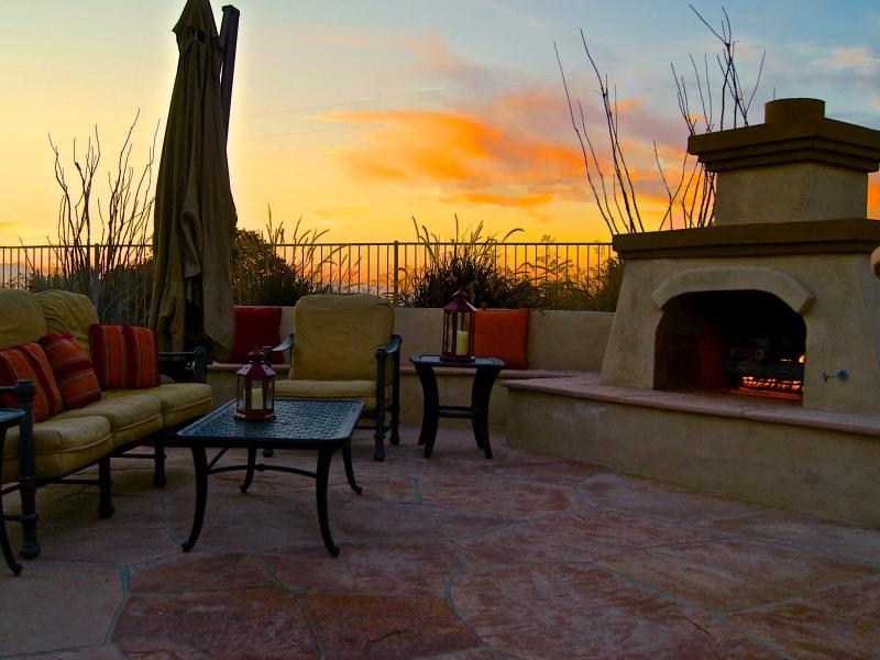 Outdoor Fireplace and sitting area - Beautiful Backyard with Golf Course View, Pool - Goodyear - rentals