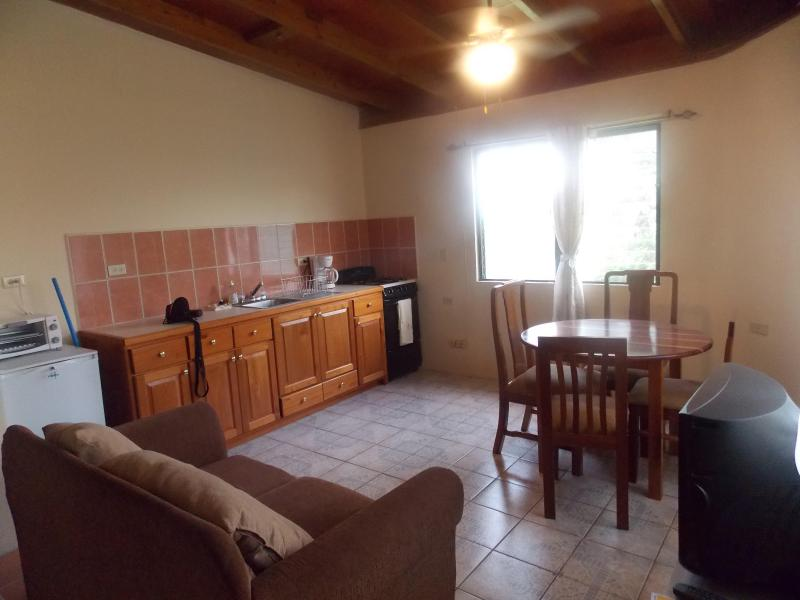 High efficiency unit, beautifull cabinets, stove and fridge.  Four seater dining table, sofa set and cable tv. - Arabella - San Ignacio - rentals