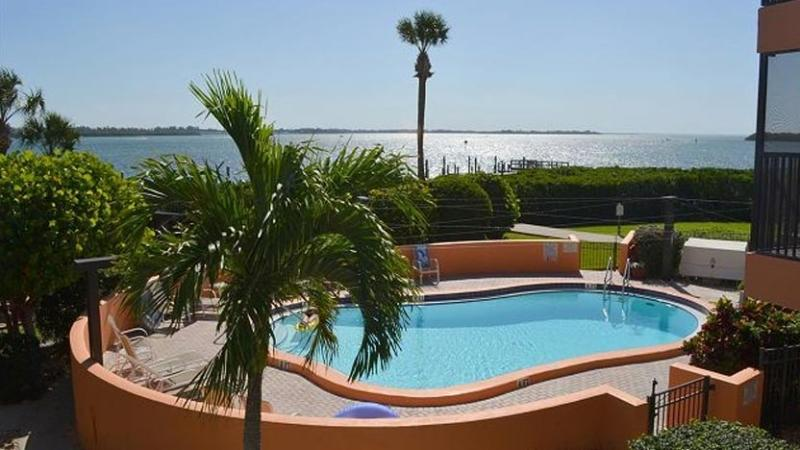 Pool has View of Sarasota Bay - Bay to Beach: 3BR Condo with Pool and Boat Slip - Bradenton Beach - rentals