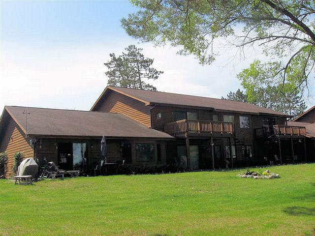 Grassy walkout from your villas - Eagle Pointe Villa On lake & Snowmobile Trl Yr Rd - Junction City - rentals