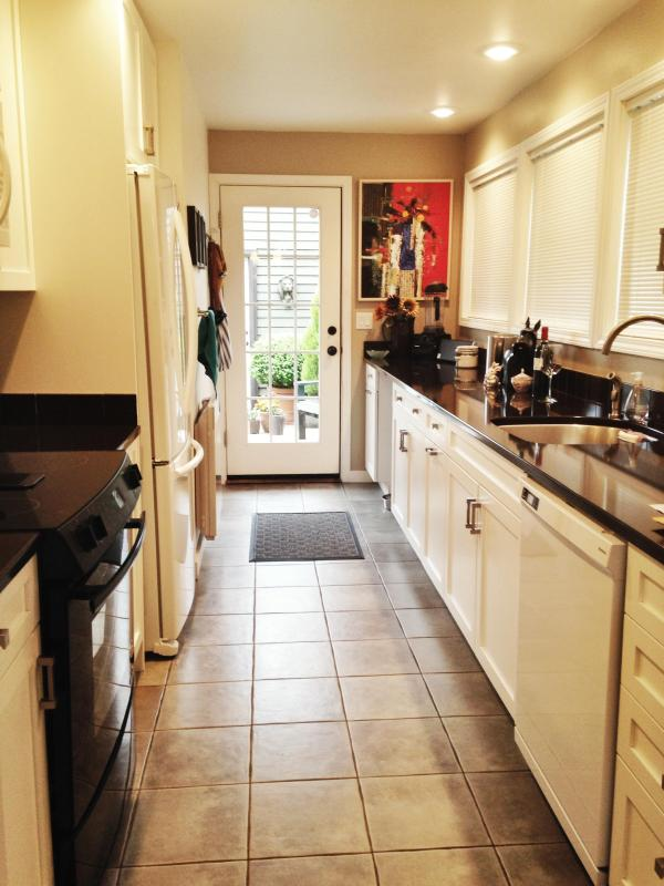 The kitchen which comes fully equipped with pots, pans, silverware, dishes and microwave. - Latona House - Charming Seattle/Green Lake Home! - Seattle - rentals