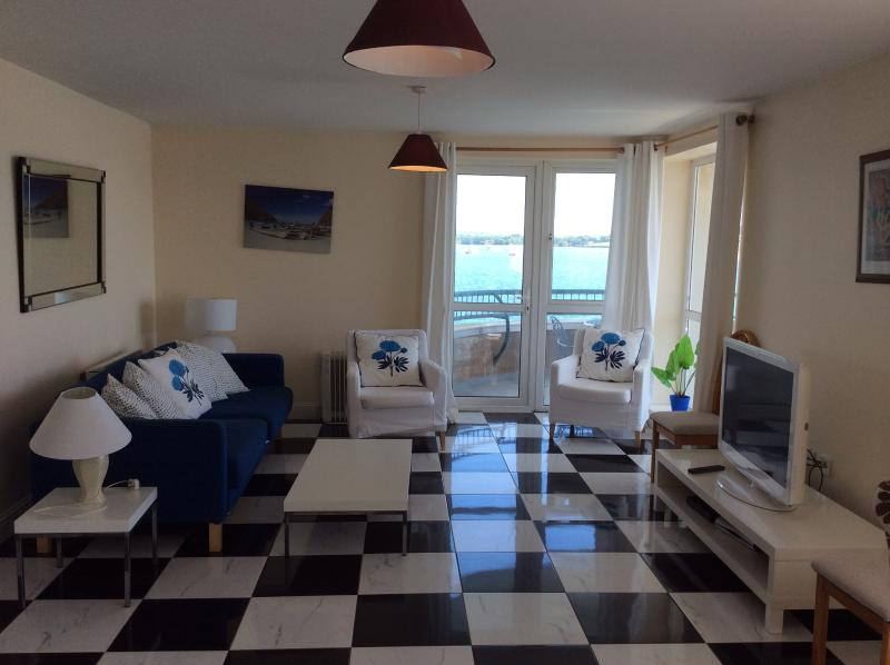 Living room and door to balcony - Harvey's Waterfront - Herons Landing - Youghal - rentals