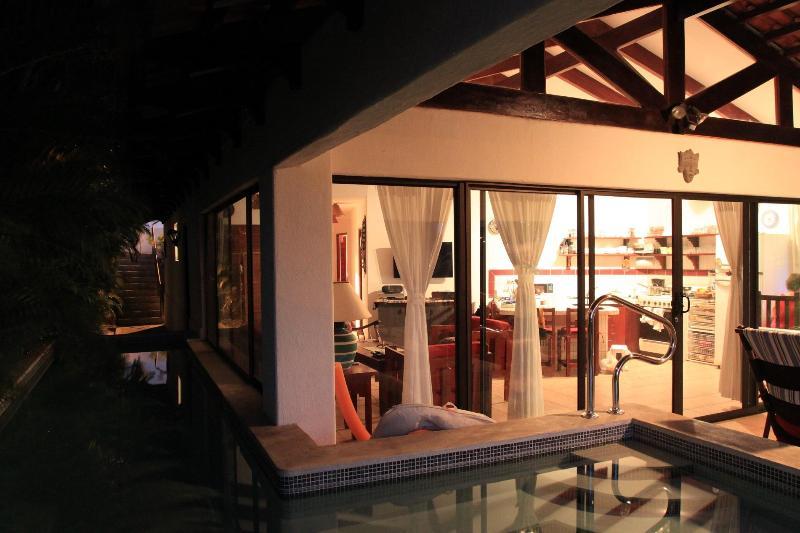 Evening view of the villa, looking across the pool into the villa. - Villa Concha Fina - Costa Rican beach Villa - Playa Hermosa - rentals