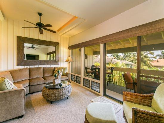 living room - Manualoha 609, Wonderful 2bd/2bth with beautiful ocean views just steps from Brenneckes Beach, Pool, BBQ. Free car* with stays 7nts or more. - Poipu - rentals