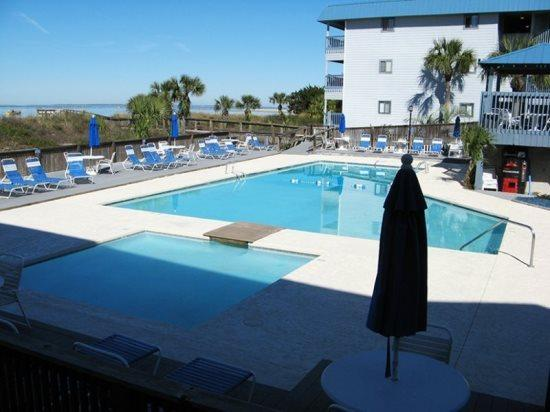 Enjoy watching dolphins in the river, shrimp boats  cargo ships entering  leaving the Port of Savannah, the swimming pool  tennis courts - Savannah Beach & Racquet Club Condos - Unit A215 - Swimming Pools - Tybee Island - rentals