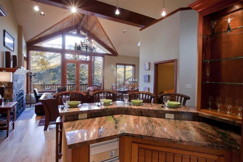 The gorgeous space has an open layout that makes it easy to navigate between the kitchen and living room. - I've got... two tickets to paradise - Private hot tub, two free lift tickets every day - North Point - Mountain Village - rentals