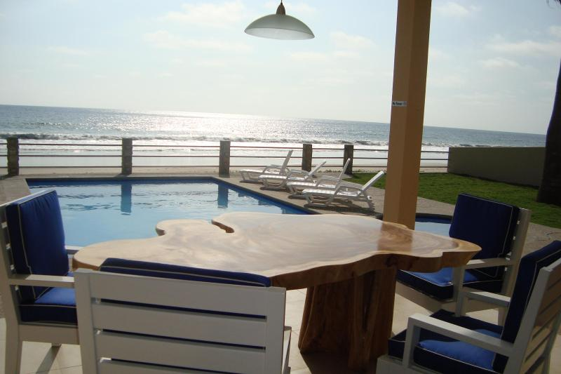 Covered patio with unique burl table and endless due west views - New Luxury Beachfront Villa with Swimming Pool & O - Montanita - rentals