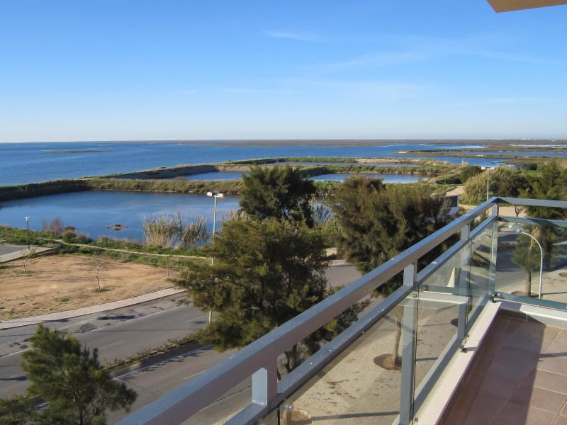 View from veranda west - VILLAGE MARINA OLHAO: luxury corner apartment with stunning, uninterrupted views of the sea, islands and lagoon - Olhao - rentals