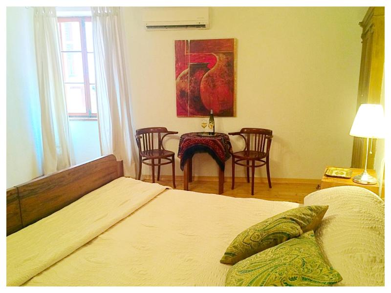 Spacious bedroom with king sized bed.  Shutters to the street below close to block light & sound. - Casa Leonora, great location in Rovinj old town - Rovinj - rentals