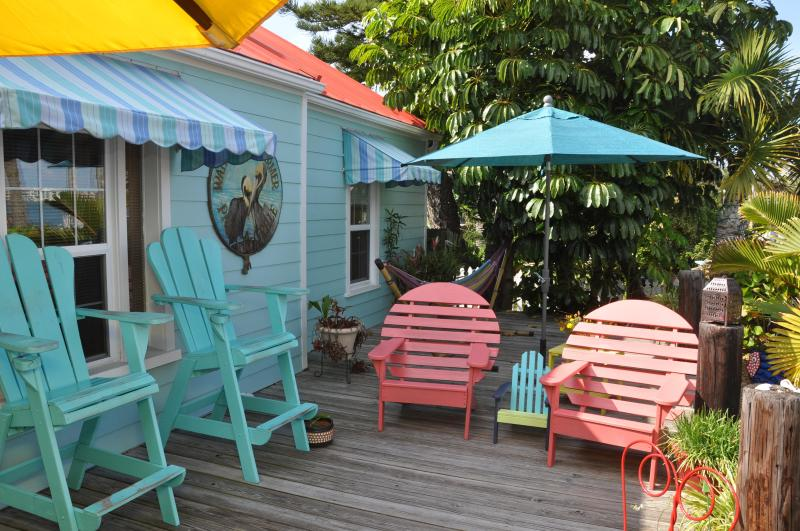 Walk up the steps to the cottage front door.  Large deck overlooks Boca Ciega Bay and Merry Pier. - Pass-a-Grille's Waterfront Charmer, Key West Style - Saint Pete Beach - rentals
