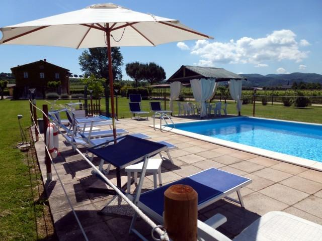 view of the Mela façade from the pool - MELA apartment with pool at I MORI GELSI, Assisi - Torgiano - rentals