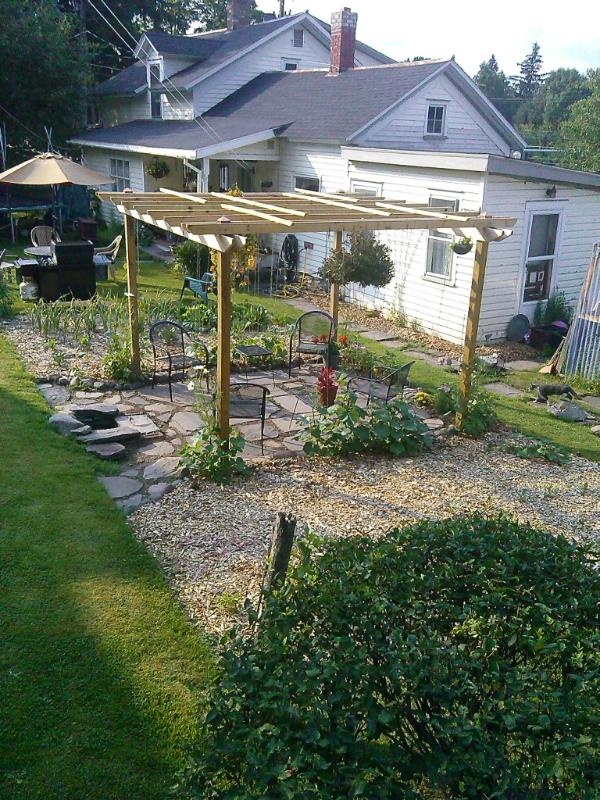 Newly Installed Pergola with fire pit...Enjoy a beautiful sunny day with outdoor seating in the garden area...and warm by the fire on a cool mountain evening. - Windham NY 2 Bedroom Rental Catskill Mountains - Hensonville - rentals