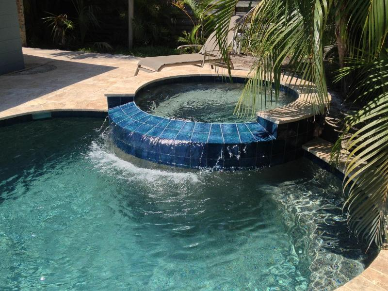 Spa with overflow to pool - 5 Bedroom w/ Lagoon pool, hot tub & golf cart - Holmes Beach - rentals