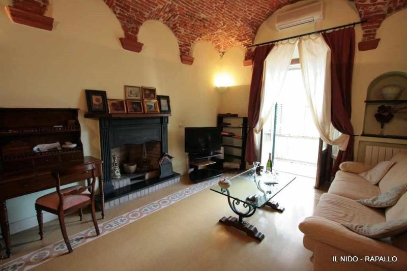 Living with fireplace - Mazzini - View on the harbour - Rapallo - rentals