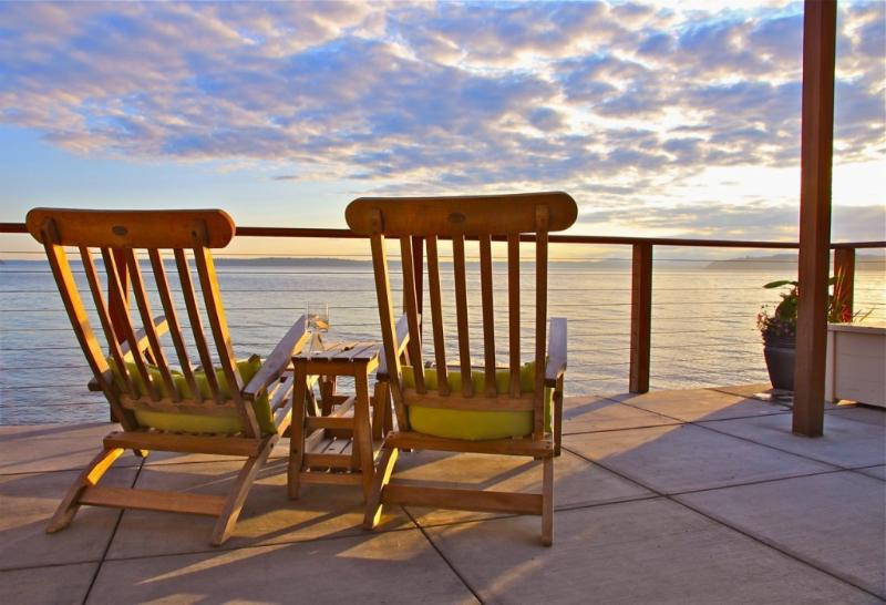 relaxing on the deck - Beachfront Condo in Rare, Stunning Location - Seattle - rentals