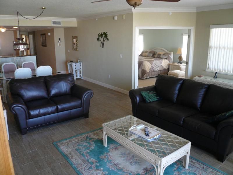 Livingroom, master bedroom w king, have patio doors to patio with oceanview - MysticVistas Oceanview w ocean access fully deluxe - Cape Canaveral - rentals