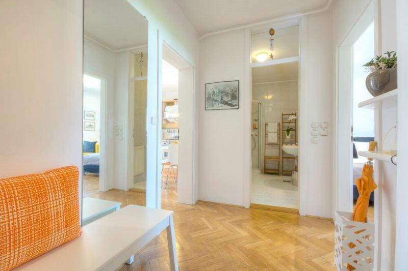 A central hallway with a closet, a mirror, and a bench to sit on for changing shoes - 1-Bedroom Ziherlova - Fine Ljubljana Apartments - Ljubljana - rentals