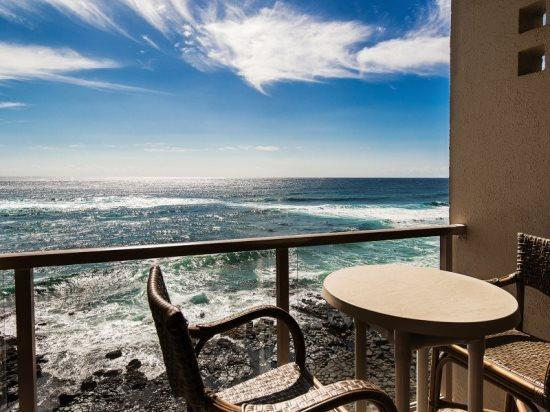 Lanai - Free Car* with Kuhio Shores 416-4th floor condo, ocean and sunset views. Watch the surfers from this ocean front 1 bedroom/1 bath condo. - Poipu - rentals