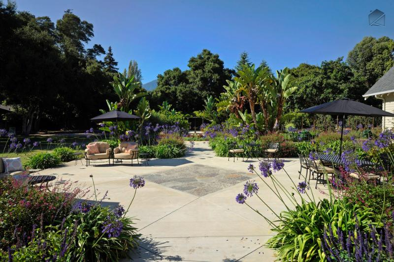 Most of the 1.6 acre estate is dedicated to a park-like backyard with a large patio with shaded dining table for 8, cozy seating areas, a couple tree swings, and extensive lawn and gardens filled with fruit trees and flowering plants. - 1.6 acres of family fun in Montecito near beach - Jameson Retreat - Montecito - rentals