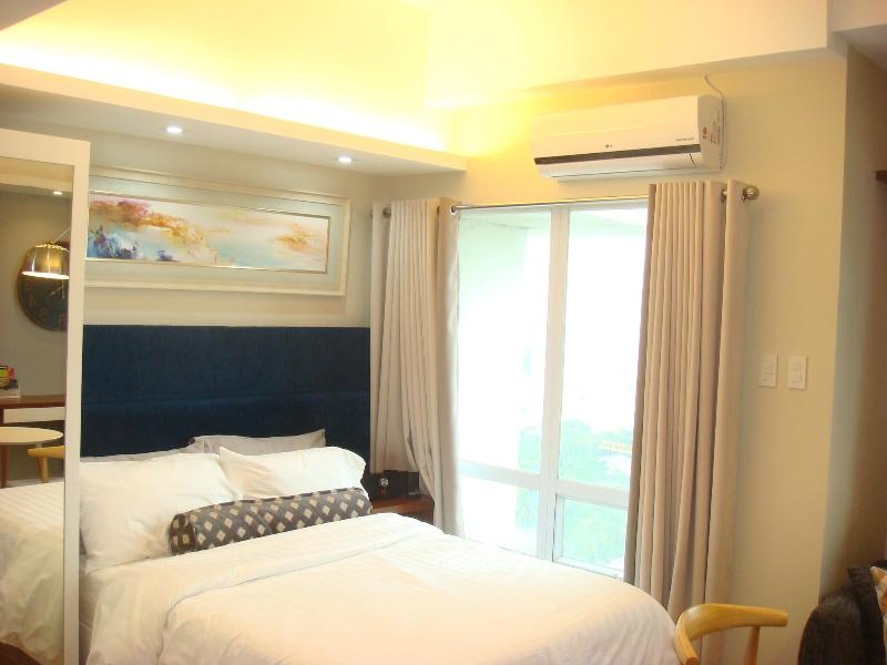 Bright and cozy apartment - COZY STUDIO with Pocket Wifi - Mandaluyong - rentals