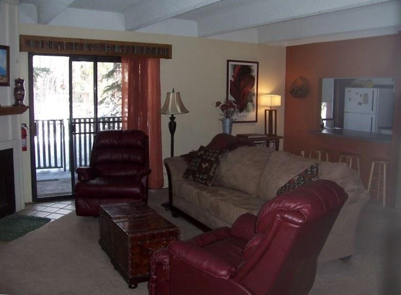 Living room of our first floor condo overlooking Ten Mile Creek - Hideaway in the heart of Frisco-WiFi, pool, sauna, hot tub - Frisco - rentals