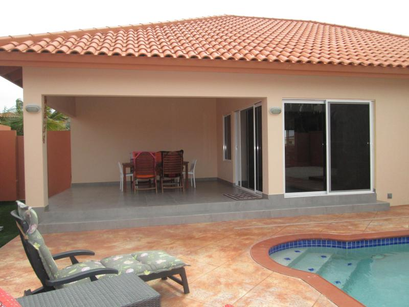 Your back yard - SUPER CLEAN BRANDNEW VILLA and pool USD 175,00 - Aruba - rentals