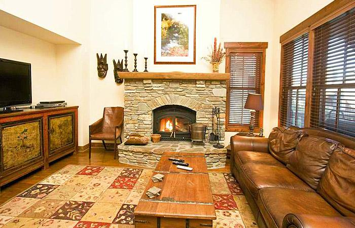 The Lodges #1119 Living Area With A Wood Burning Fireplace - The Lodges 1119 - Luxury Mammoth Rental - Mammoth Lakes - rentals