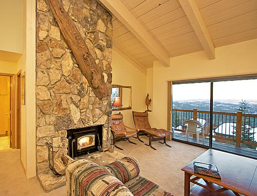 Timber Ridge #30 Living Area With A Wood Burning Fireplace and Access To The Private Balcony - Timber Ridge 30 - Ski in Ski out Mammoth Condo - Mammoth Lakes - rentals