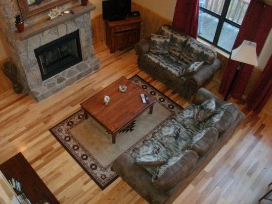 The Living Room from Above - Wolf Ridge – Secluded Log Cabin - Enjoy the outdoors through Large Windows – Indoor Jetted Tub -- Hiking at the Cabin - Bryson City - rentals